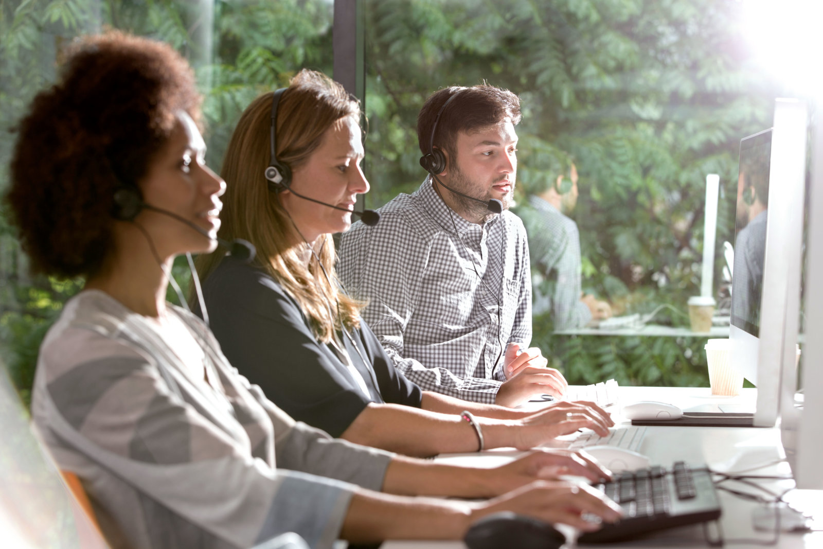 People helping in a call centre