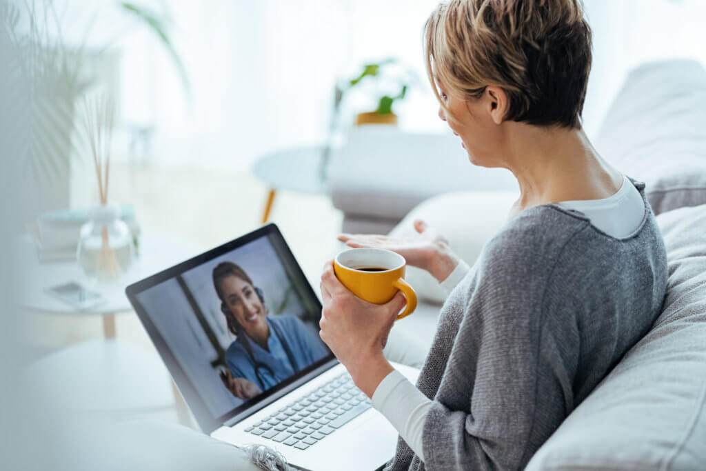Woman using laptop for video call